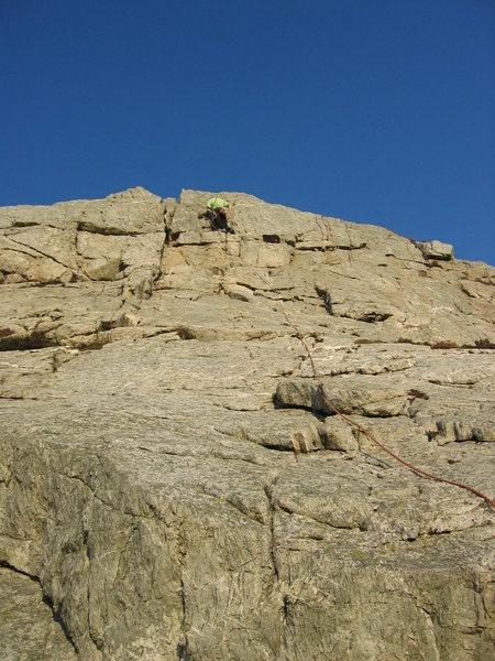 Getting some winter sunshine on easy slabs at Holyhead Mountain (photo Phil Ashton)