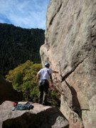 Rock Climbing Photo: Clipping the 1st bolt on Rightist before stepping ...