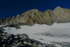 Broad eastern face and routeline as seen from approach. Note start on left (south) side of medial moraine, and hidden tower passed on route.