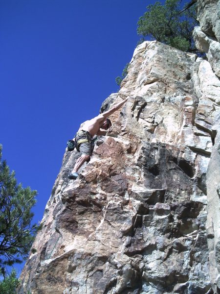 The Queen B is the face to the right of John climbing Big Boy.