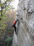Rock Climbing Photo: Moving left above the overhang.