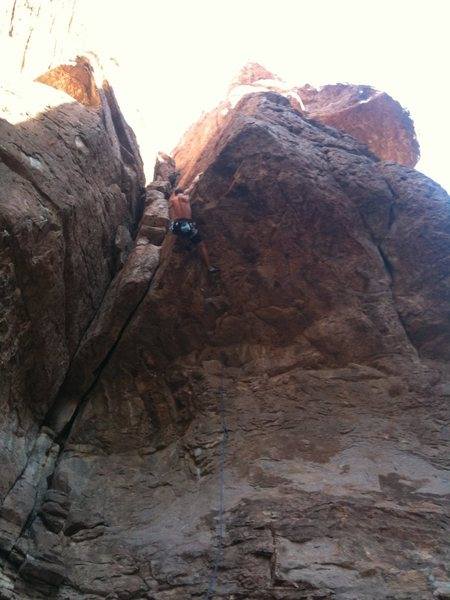 Brett Monik at the edge of the roof.