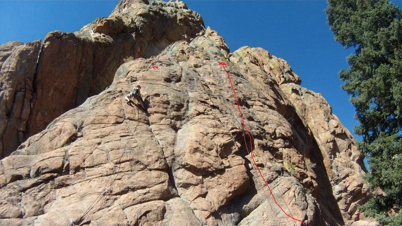 The top of Mr. Hanky. The route to the left with the climber is Junk In The Trunk, 5.9.<br> <br> Climber: Paula.