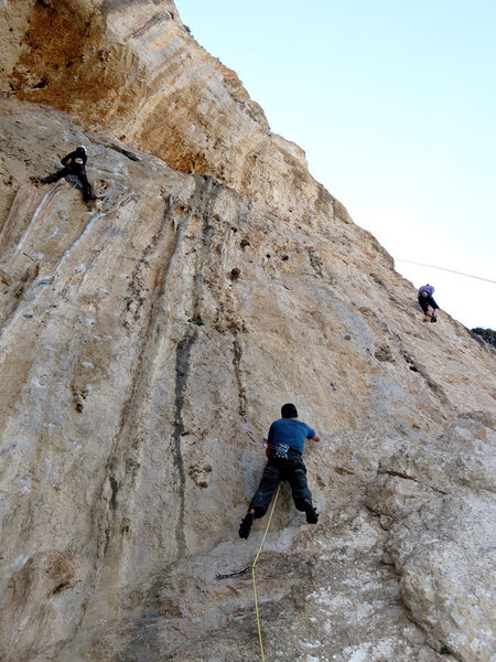Matt Nance checking out the route AND the local Kalymnian honey on the start of &quot;Nabuchodonosor.&quot;<br> <br> Honey on right is on &quot;Le 13eme Travail d'Hercules.&quot; (Climb ends directly above her.) Honey on left is scaling up &quot;Les Amazones.&quot;