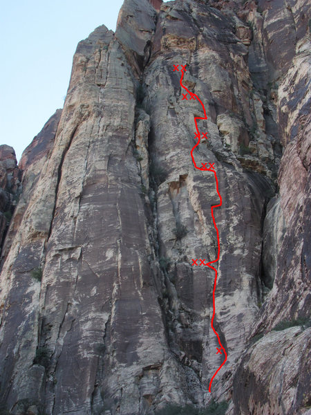 A photo with the route and bolts marked on it.