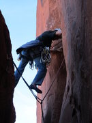 Rock Climbing Photo: Making the move into the OW section.  It's a long ...