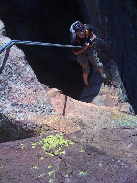 Looking down the rappel of The Maiden.  Climber: R. Bame. Photo by K. Decker.