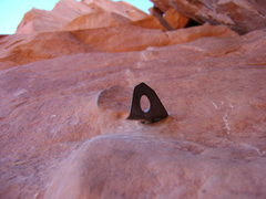Rock Climbing Photo: The bolt protecting the offwidth on P2.  Photo sho...