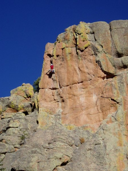 Above the technical crux (which is just below the hoizontal), at the end of the burly layback section.<br> <br> Photo by: Ivan Rezucha.