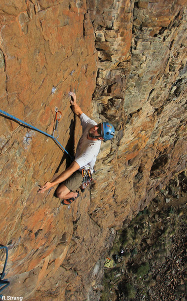 Alex Scott moves across the steepening face towards the pitch 1 belay<br> Xibalba (5.10+)