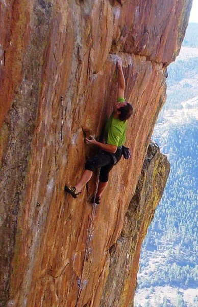 Sticking the crux dyno to the top of the Africa Plate.<br> <br> Photo by Ken Klein.