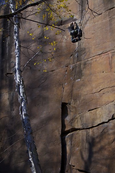 Tyler enjoying another creative and playful rest on his newly bolted climb, Nexus.