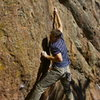 Trying hard to crimp the new broken hold.  Photo by Pat Smalley (when he should have been studying down at the library).
