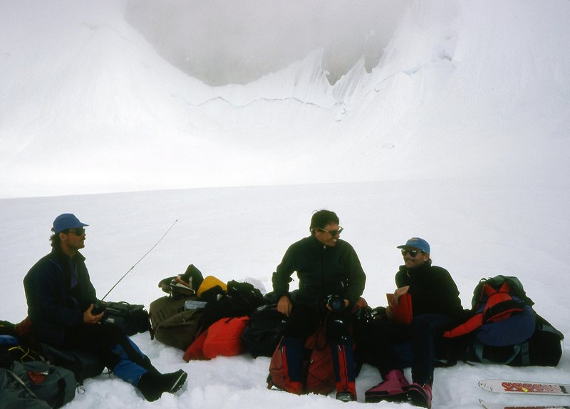 J. Burton, G. Child & M. Kennedy waiting for a ride on the Tokositna Glacier 1993.