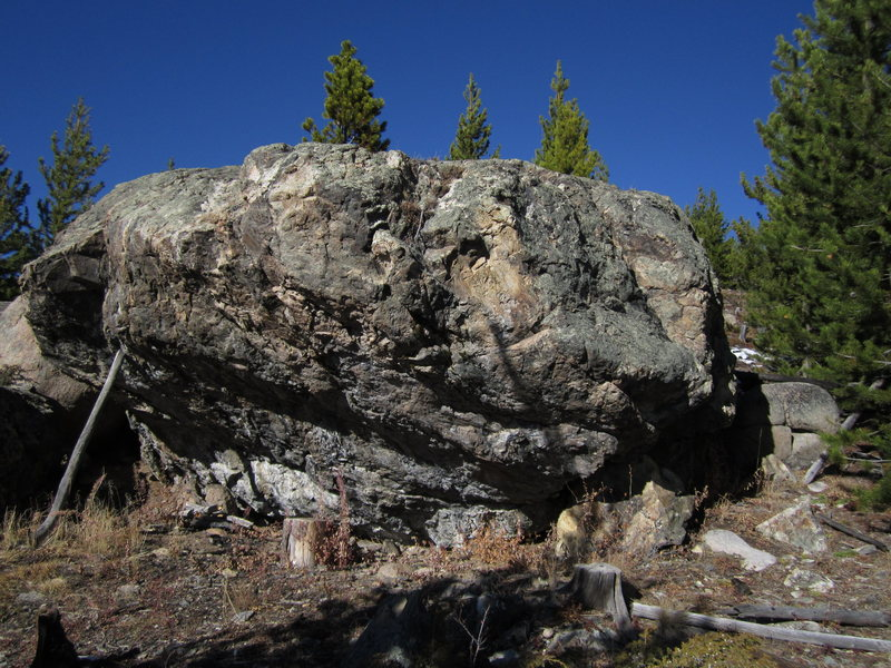 Overhanging south face.  The start is just right of the center of the boulder.  Right hand sloping crimp, left hand gaston.