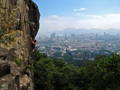 Rock Climbing Photo: Blue Cross with Hong Kong in the background