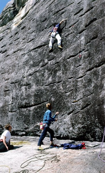 Whitney H. on lead with Jeff L. belaying and Monty on Guard, FA 1987.