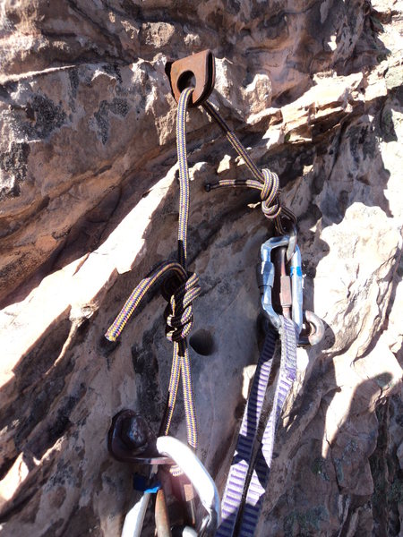 This is the top rap anchor due east of the mushroom boulder at the top of New Era.<br> <br> Note, the left bolt was a bit loose.<br> <br> It's about 80' down to 2 possible rap anchors.