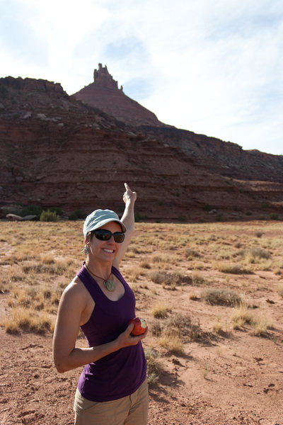 Polly pointing at the South Six Shooter tower (climbed day 6 in the Creek)