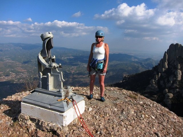 Summit belay/rappel anchor (!) on Cavall Bernat.<br> <br> Barcelona in the distance (upper right).
