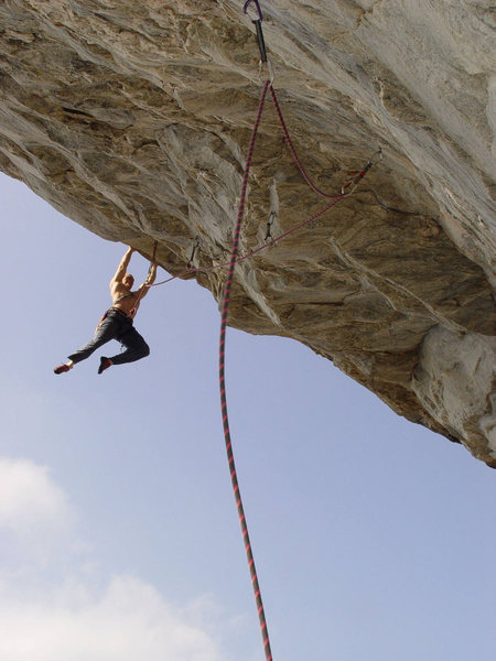 Seth Tart on Zeus (5.13b).<br> <br> Photo by David Hill.