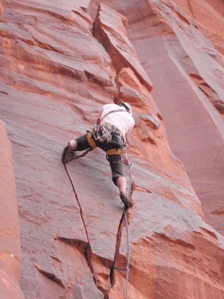 Brennan Crellin on first ascent, moving through twin cracks section