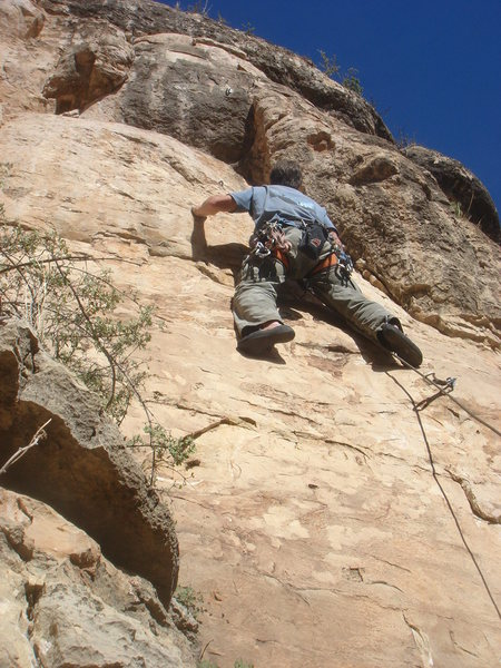 Working the thin slab low on the route.<br> <br> Photo by Dave Wayne.