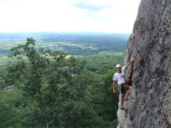 Rock Climbing Photo: Unknown climber at the crux bulge on p. 2 of Grand...