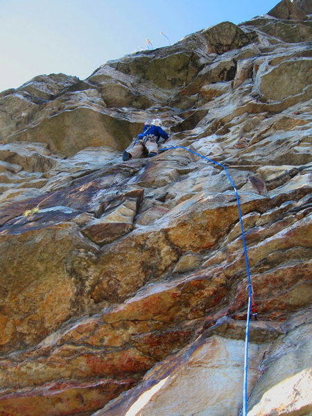 Lucander engaging the bolted crux section on p. 2 of Keep on Struttin.