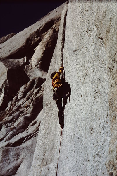 Mark Ward nearly pulling off a free ascent of the thin crack crux.  Mid 70's