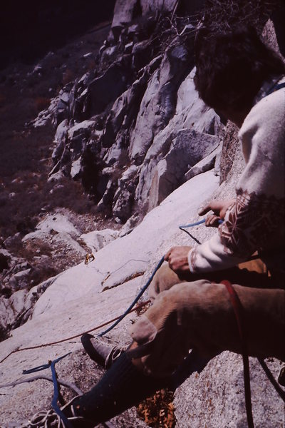 Dave Smith following pitch 2 with limited pro.  Early ascent - probably '76.<br> <br> Knickers!