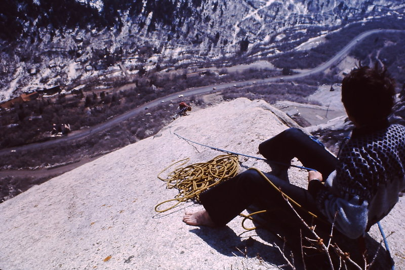 Top of the Dorsal Fin on a fine winter day in the mid 1970's.  Probably Jim Knight in the painter pants.  Kim Miller in the bell bottom cords giving a hip belay - tied to a bush.