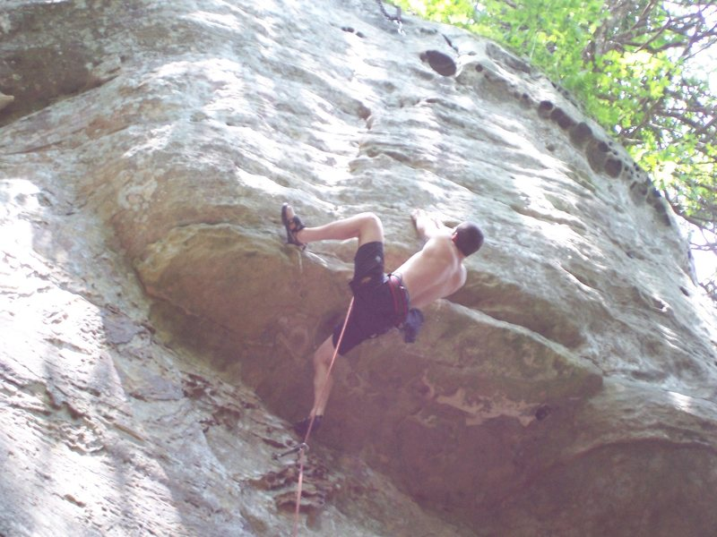Redpoint crux, one last move to the good layback.