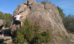 Austin on the Goodnight boulder, crux moves of Unscarred
