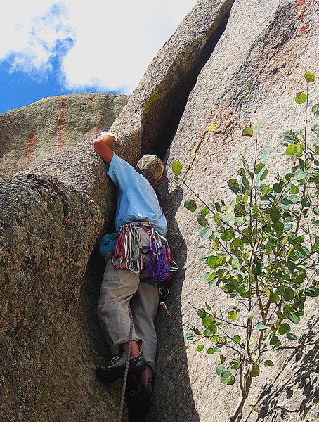 Rock Climbing Photo: Ben starting up Crackpod.