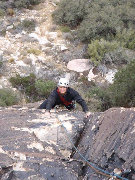 Solar Flare pitches 1 & 2 combined - climbing the corner after the crux roof.