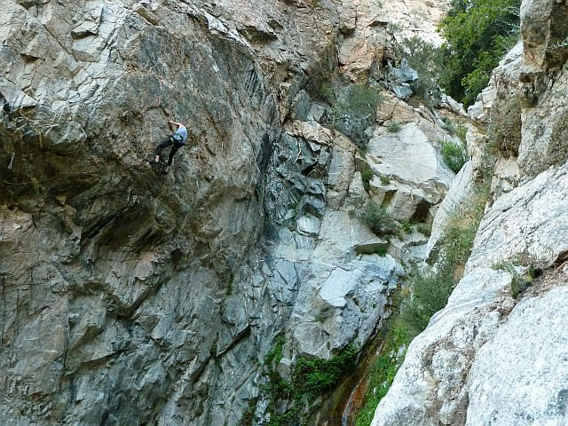 Chris S. working Evisceration (5.13c), Frustration Creek