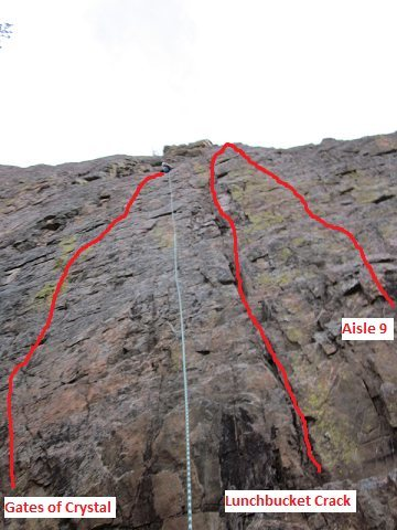 At the top of this route, there is a nice little ledge to stand on to hook into the anchors.  The Gates of Crystal route is to the left of the rope and angles to the right.  Lunchbucket follows the obvious crack and shares an anchor with Clean-Up on Aisle 9 which is just to the right of the crack.
