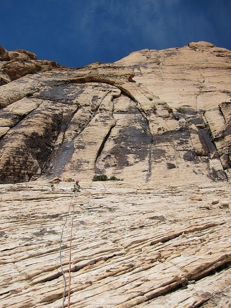 View of the slab from the 4th pitch of Johnny Vegas. Solar slab is follows the handcrack to the right of the arch, then up the top of the arch. Heliotrope is the crack up and right of the initial handcrack.
