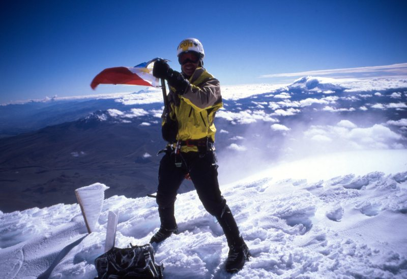 waving my flag, Cotopaxi summit.  summer 2002. Photo hans or jon