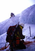 me belaying Jon down and across the upper schrund, Cotopaxi, Ecuador. photo. Hans