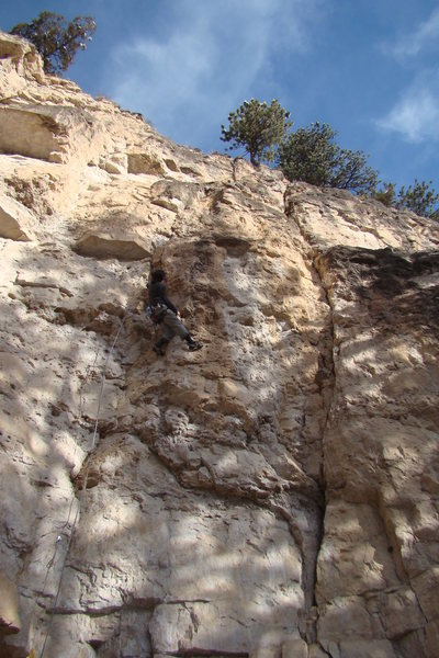 The crux of Pocket Pool, 5.10a<br> The Coin Shop<br> Sunshine Wall<br> Spearfish Canyon, SD.