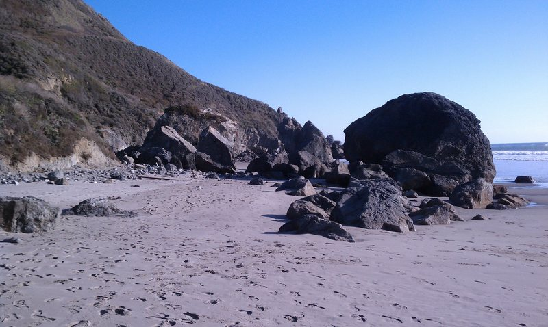 Numerous boulders SE of Stinson beach with a variety of routes. View from the NW.