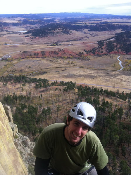 The Wyoming landscape behind me as I top-belay pitch 2 of the Durrance route at Devil's Tower in October 2011