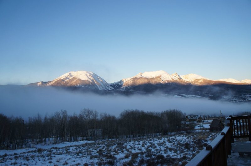 Sunrise over Buffalo Mountain and Gore Range, steam rising from Lake Dillon.