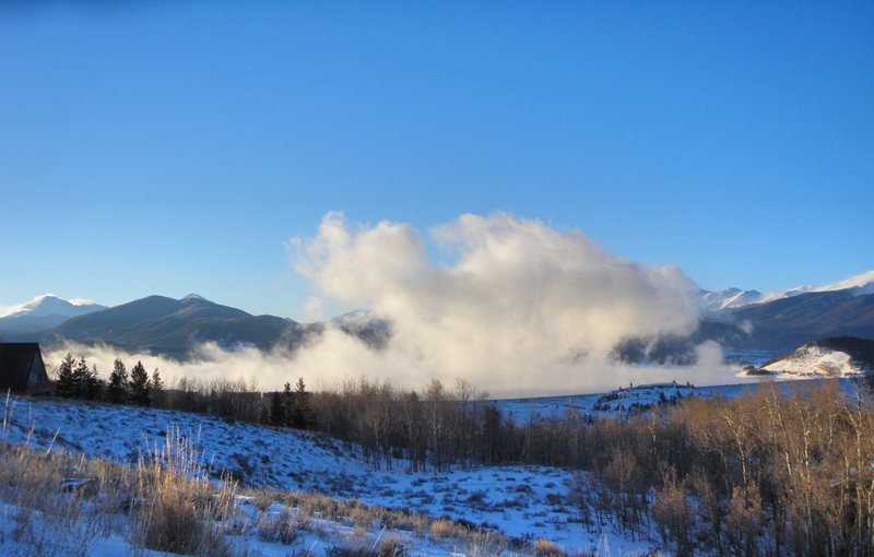 Tenmile Range hidden by steam from Lake Dillon.