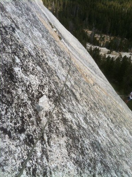 Pitch 3: Pro is behind the flake straight up from the belay