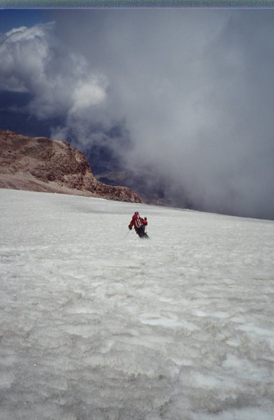 Newel Jensen dropping the knee, above the clouds on our telemark ski descent of Orizaba in 1997.