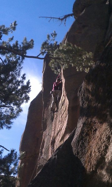 Zack climbing the naturals upper face.