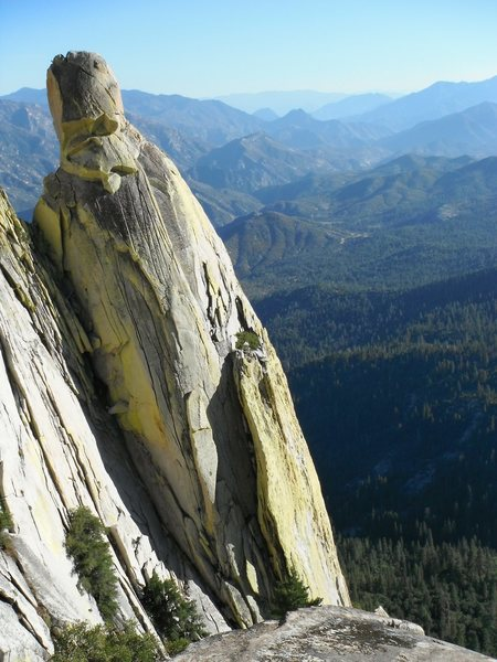 The sunny west face of Wizard Needle.